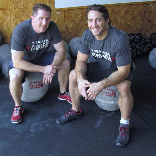 Tim Kennedy (R) trains at Trauma CrossFit and represents the affiliate on his shorts at each UFC fight.