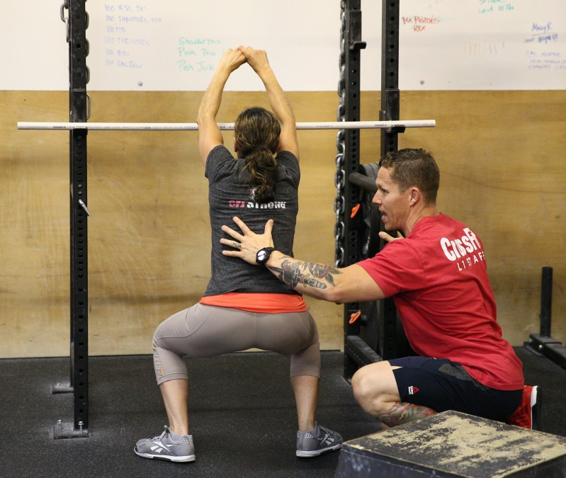 Matt Chan, working with a participant at the CrossFit L1 Trainer Course.