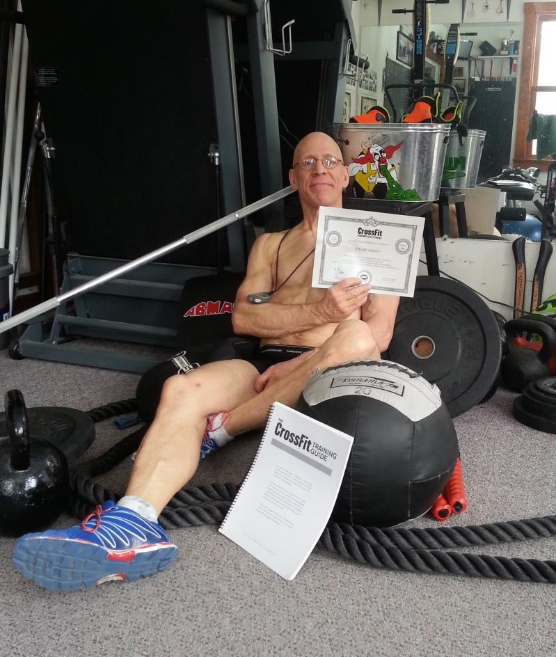 CrossFit Trainer Stuart Ashley, holding his L1 Course Certificate.