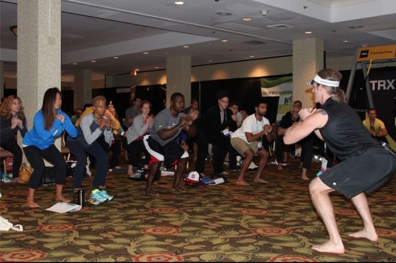 Squat instruction at an NSCA conference: https://www.facebook.com/NSCAofficial/photos/pb.248618385223246.-2207520000.1419363147./715033405248406/?type=1&theater